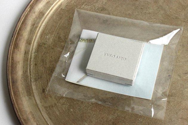 佐藤祐子さんのジュエリー作品「petit seed ハーキマーイヤリング」のパッケージ