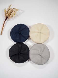 mature ha.  beret top gather linen