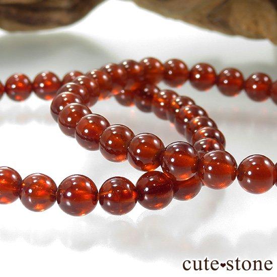 【1/2売り対象】ヘソナイト(オレンジガーネット) AAA のシンプルブレスレット 5.5mmの写真1 cute stone