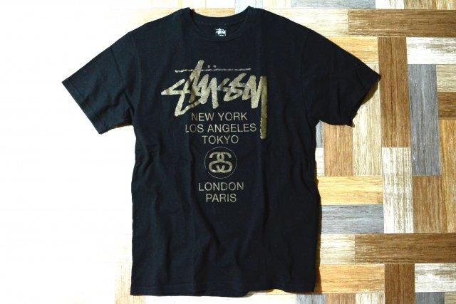 STUSSY ワールドツアー Tシャツ ブラック×ゴールド (メンズ古着)