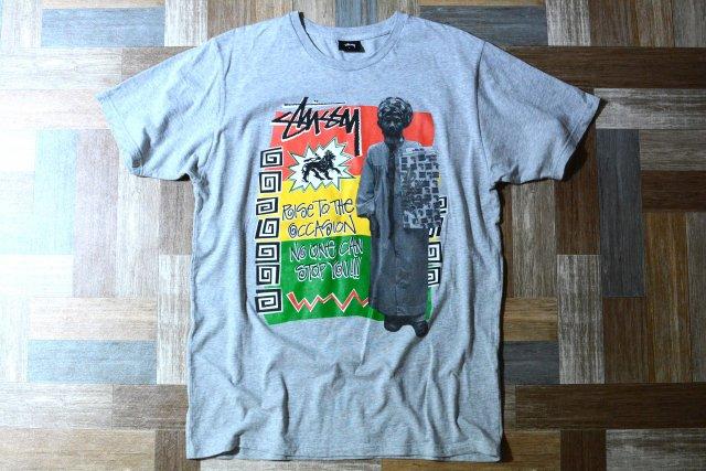 STUSSY ラスタ フォト Tシャツ 杢グレー (メンズ古着)