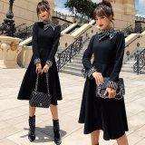 黒フレアスカートとストライプ柄が可愛い韓国ワンピース デコルテのリボンが個性的なハイネックのパーティードレス