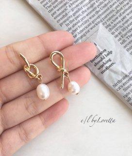 Tie pearl pierce