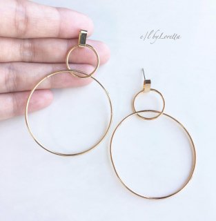 Gold w hoop pierce