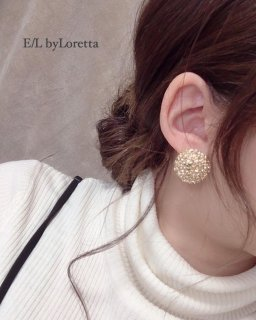 Gold circle motif pierce