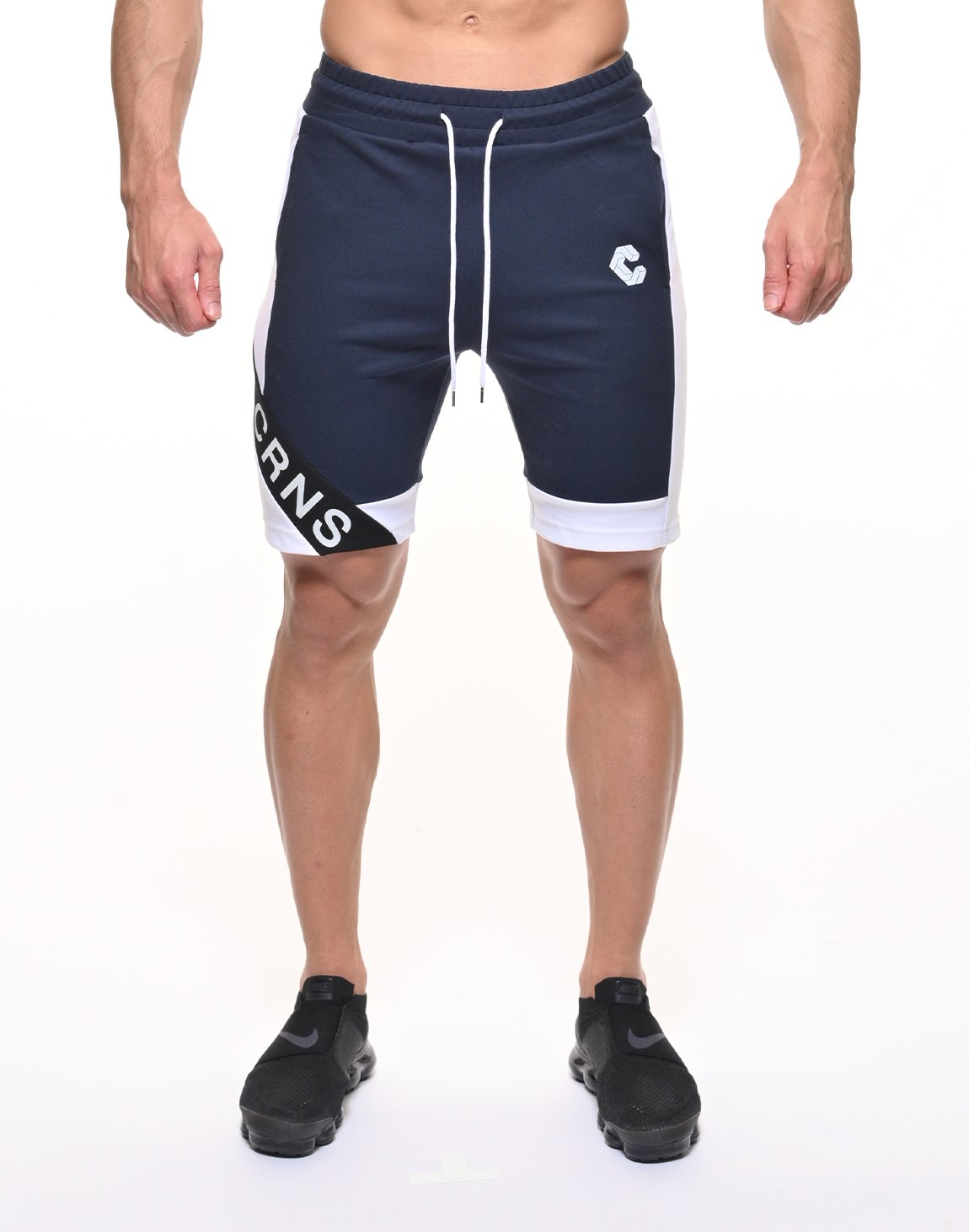 <img class='new_mark_img1' src='https://img.shop-pro.jp/img/new/icons1.gif' style='border:none;display:inline;margin:0px;padding:0px;width:auto;' />CRNS DIAGONAL LINE SHORTS【NAVY】