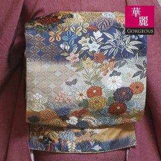 【六通袋帯】段切りの地に四季花の唐織