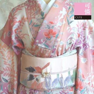 【小紋[袷]】ピンクの草木のシルエットに花模様