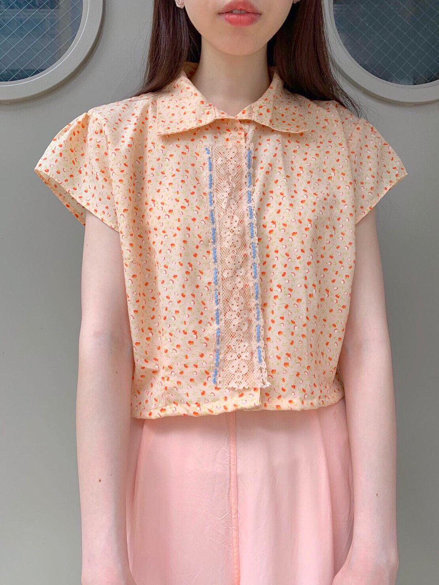 orange × flower blouse