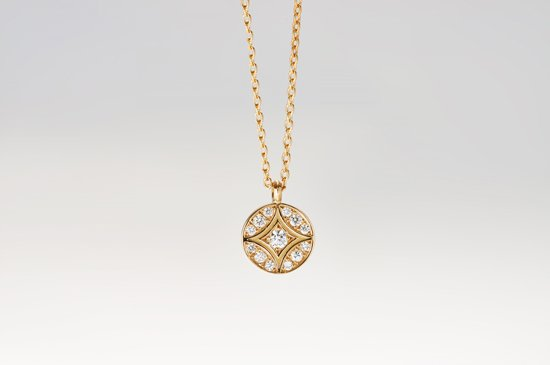 large seven tressures pendant with diamonds