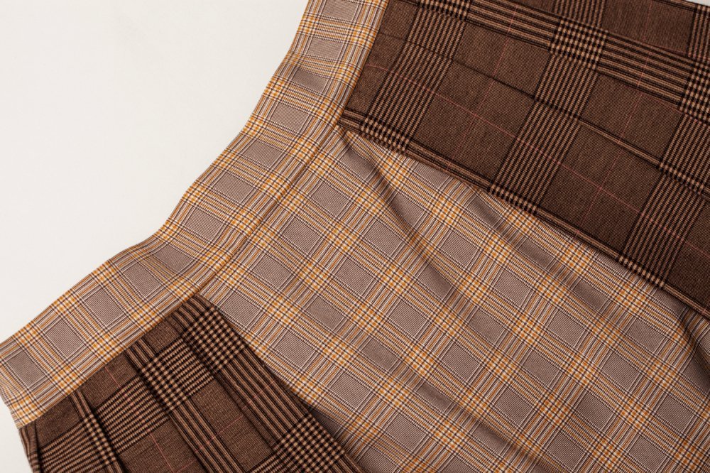THE CHECK ON CHECK PLEATED WRAP SKIRT