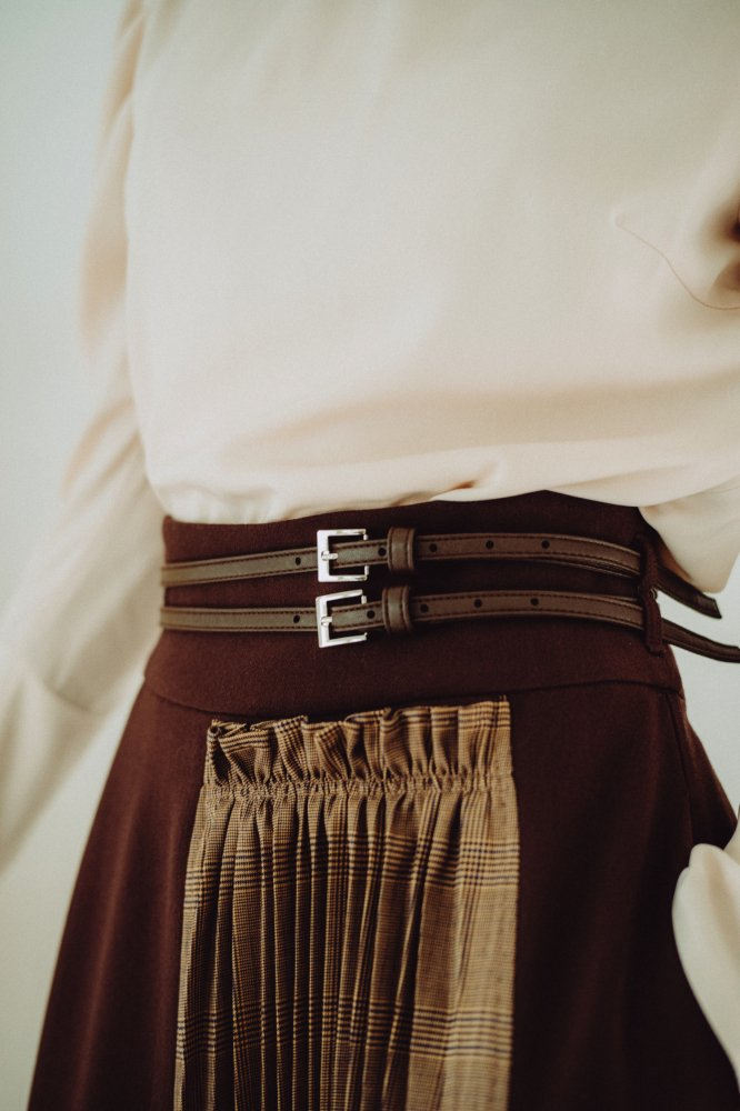 THE CHECK PLEATS DOCKING SKIRT WITH BELT