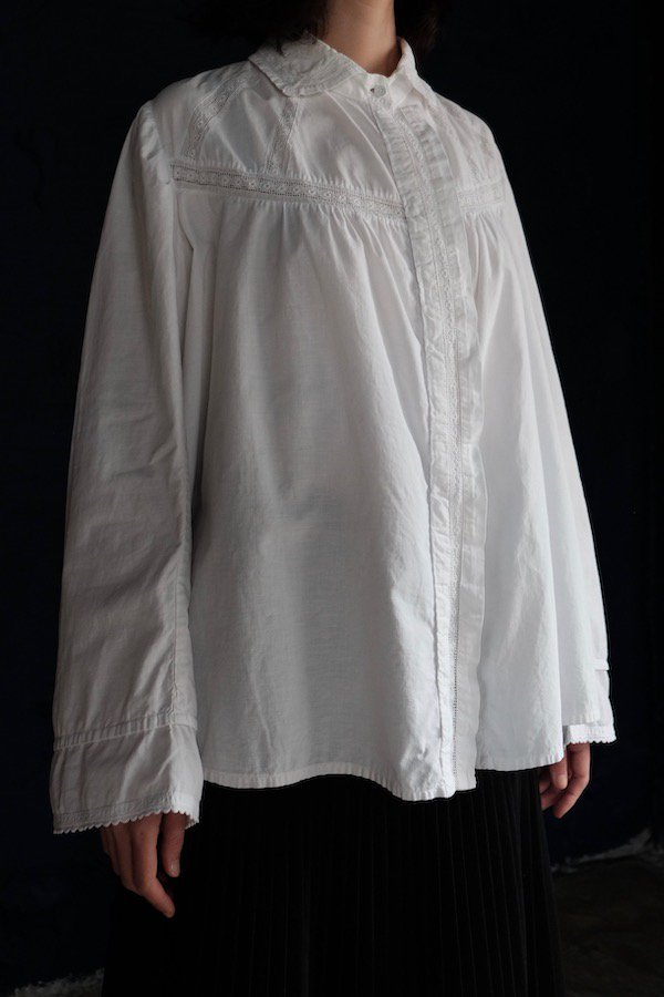 Classic white lacy blouse with thread buttons