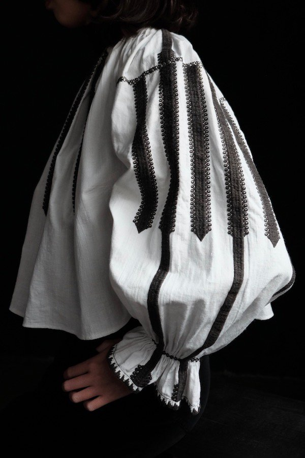 Romanian pintucked blouse with trumpet sleeves