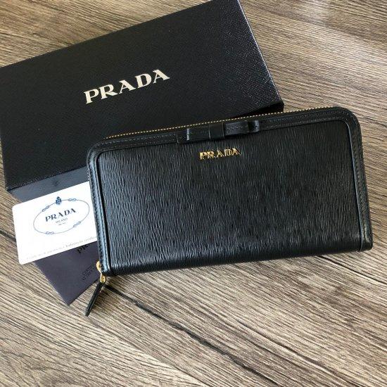 quality design d1e73 fca88 PRADA 新作 サフィアーノリボン ラウンド長財布