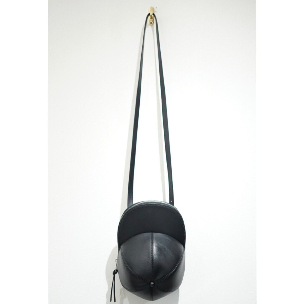 JW ANDERSON-CAP BAG LEATHER BLACK