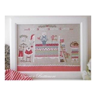 イタリア Cuore e baticuore(クオーレエバッティクオーレ) クロスステッチ図案 Santa Claus on the pea ベッドの上のサンタクロース