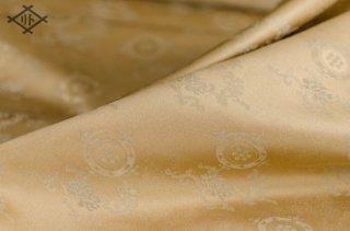 二丁源氏緞子・正絹・薄茶・七曜宝丸唐花紋(20センチ〜・価格は10センチあたり)