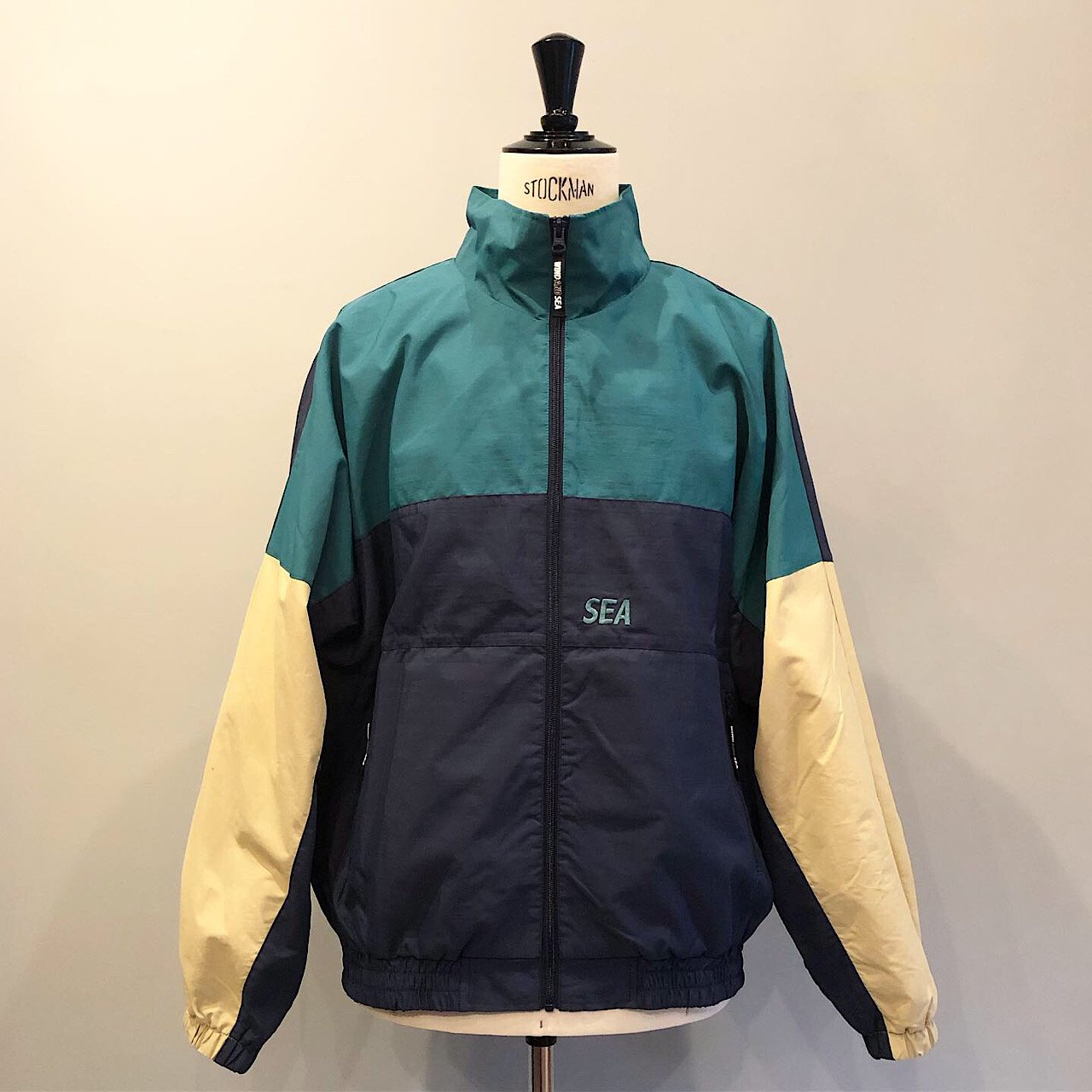 WIND AND SEA<BR>TRUCK JACKET<BR>NAVY/GREEN