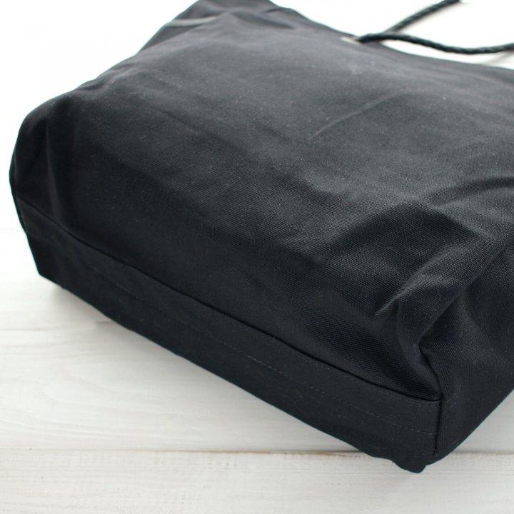 編み込みレザーハンドルとキャンバスのトートバッグ
