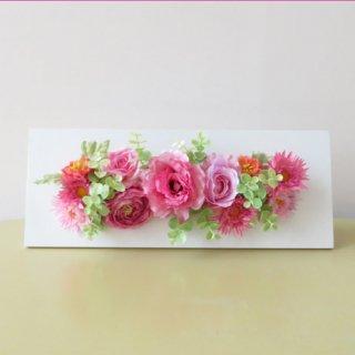 光触媒アートフラワーアレンジメント【セフィーロ(壁掛け)】ピンクの花々の中でユーカリの緑が可愛い、フレームアレンジです