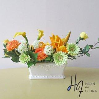 高級造花インテリア【アニェラ】黄色のカラーとオレンジのラナンキュラスのアレンジです。