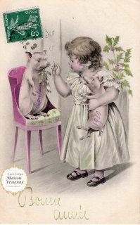 フランスアンティーク ポストカード ヤドリギをくわえるブタさんに何か言い聞かせる少女【普通郵便送料無料】