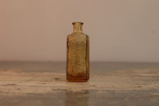 VINTAGE GLASS MINI BOTTLE JAUNDICE BITTERS