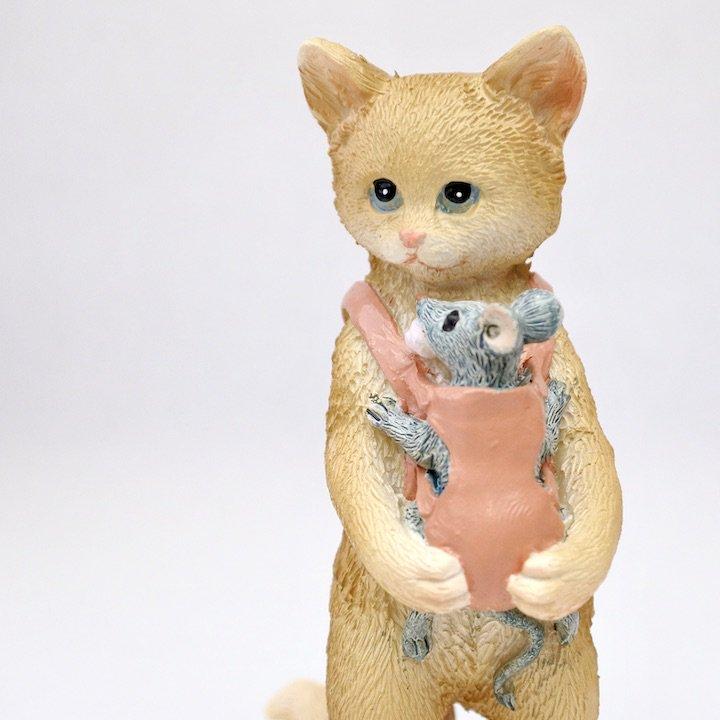 ネズミ抱っこネコ
