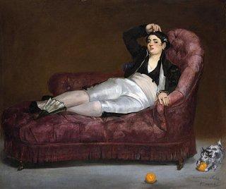 スペインの衣装を着けて横たわる若い女