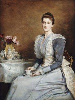 お茶の席に着くジョセフ・チャンバーレイン夫人