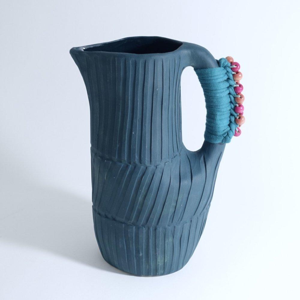 blue green jug
