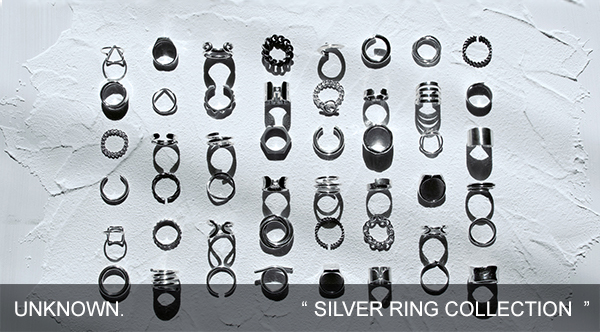 UNKNOWN. SILVER RING COLLECTION