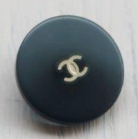 834 CHANEL(ヴィンテージ シャネル) COCO マーク デザイン ボタン グレー
